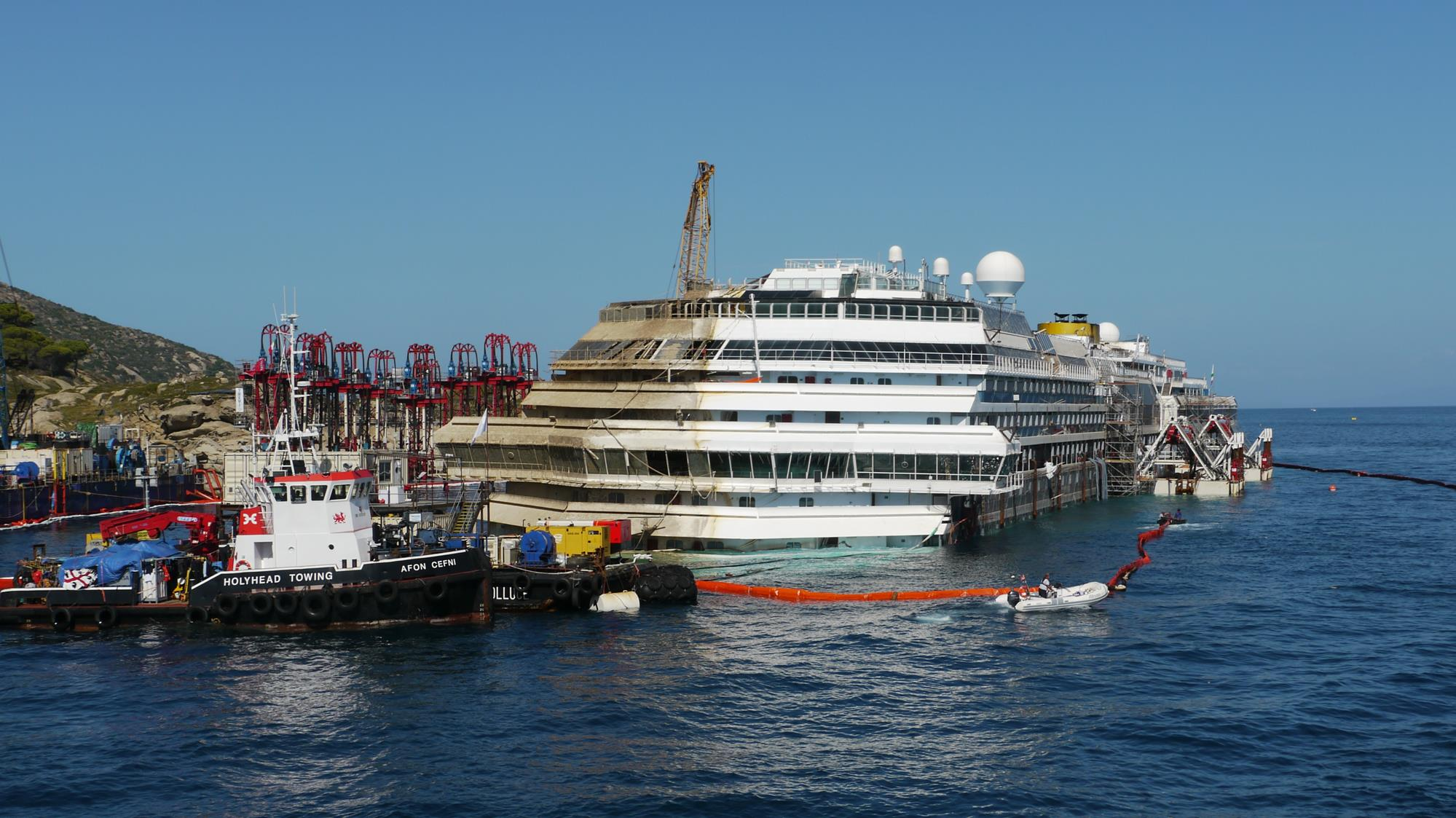 The Costa Concordia, three days after it was righted, but still two thirds underwater